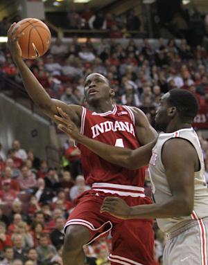 Indiana's Victor Oladipo, left, shoots over Ohio State's Evan Ravenel during the second half of an NCAA college basketball game on Sunday, Feb. 10, 2013, in Columbus, Ohio. Indiana defeated Ohio State 81-68. (AP Photo/Jay LaPrete)