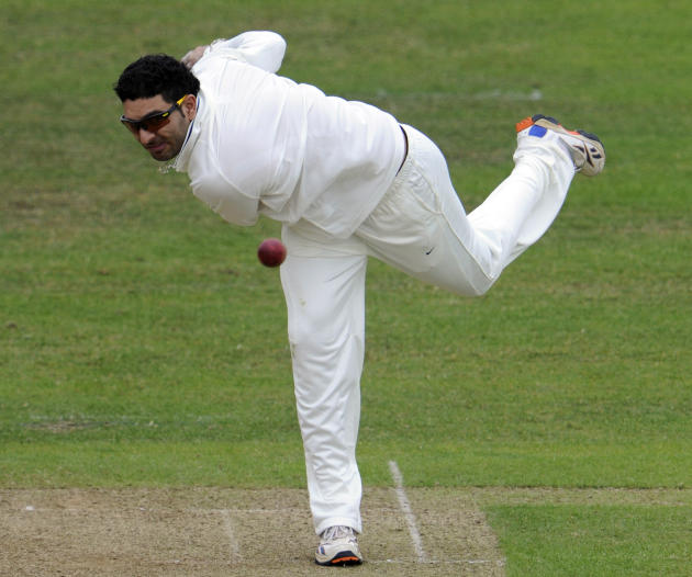 India's Yuvraj Singh bowls a ball to Somerset's Arul Suppiah during their tour match against Somerset in Taunton, England, Friday July 15, 2011. (AP Photo/Tom Hevezi)