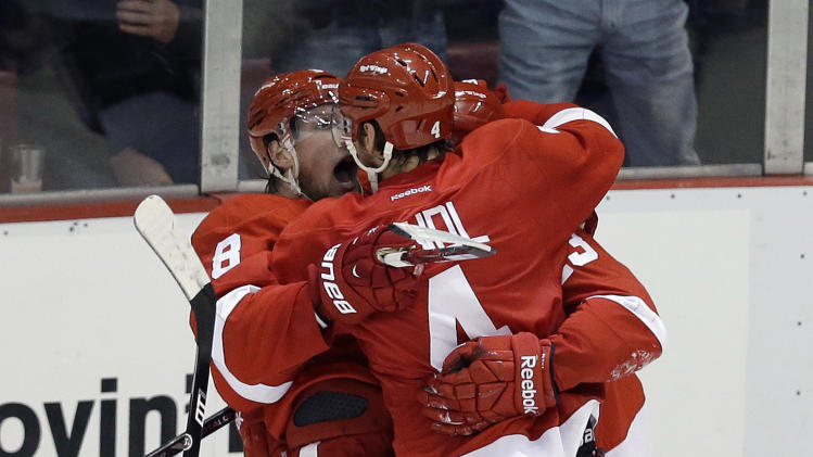 Detroit Red Wings defenseman Jakub Kindl (4), of the Czech Republic, celebrates his goal against the Chicago Blackhawks during the second period in Game 4 of the Western Conference semifinals in the NHL hockey Stanley Cup playoffs in Detroit, Thursday, May 23, 2013. (AP Photo/Paul Sancya)