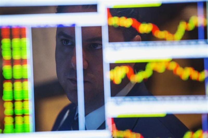 A trader looks at a screen as he works on the floor of the New York Stock Exchange shortly after the opening of markets in New York, September 4, 2013. REUTERS/Lucas Jackson