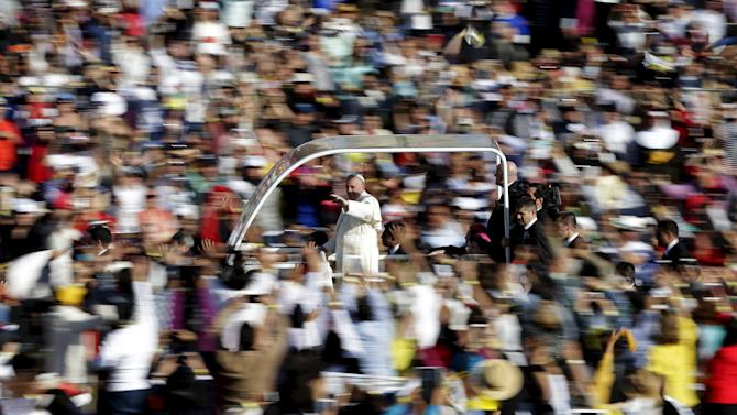 Pope Francis waves to the crowd while arriving to celebrate mass at Guadalupe's basilica in Mexico City,