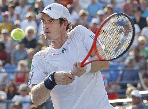 Britain's Andy Murray returns a shot to Spain's Feliciano Lopez in the third round of play at the 2012 US Open tennis tournament,  Saturday, Sept. 1, 2012, in New York. (AP Photo/Mel C. Evans)