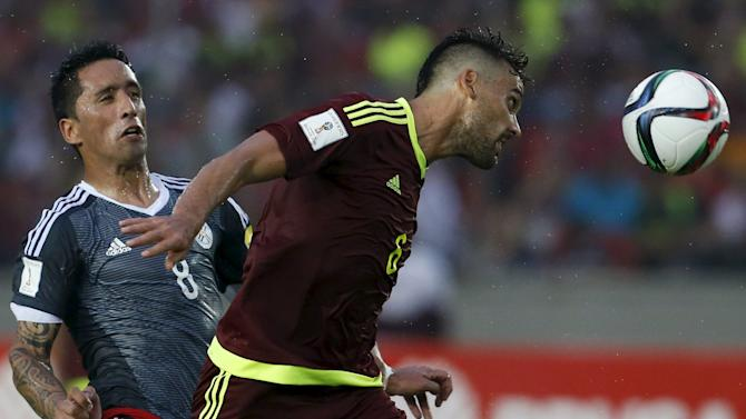 Venezuela's Cichero fights for the ball with Paraguay's Barrios during their 2018 World Cup qualifying soccer match at Cachamay stadium in Puerto Ordaz