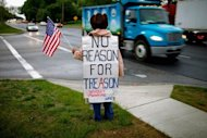 File picture shows a supporter of Private Bradley Manning, the US soldier charged with passing a trove of classified documents to WikiLeaks, standing vigil outside the front gates of Fort Meade, Maryland. Lawyers for Manning accused the military of withholding hundreds of emails over fears of a publicity nightmare