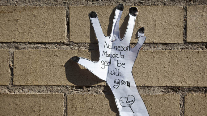A get-well message left by a wellwisher hangs on the wall of the Mediclinic Heart Hospital where former South African President Nelson Mandela is being treated in Pretoria, South Africa Sunday, June 16, 2013. (AP Photo/Ben Curtis)