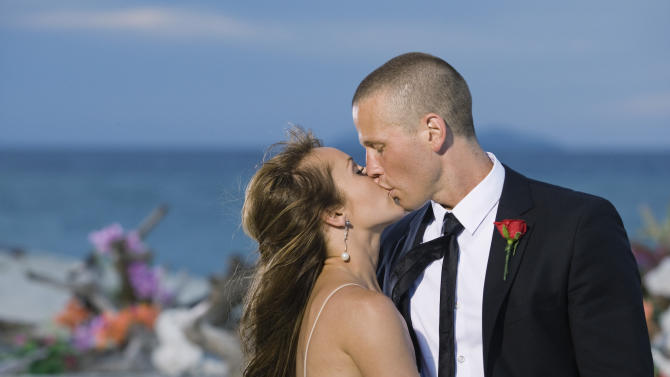 """FILE - In this publicity file photo provided by ABC, """"Bachelorette"""" Ashley Hebert kisses J.P. Rosenbaum on the season finale of """"The Bachelorette"""" in Fiji. Hebert chose the 34-year-old construction manager over winemaker Ben Flajnik from California in Monday's two-hour finale. """"The Bachelorette: Ashley and J.P.'s Wedding"""" will air in December 2012 and show everything from Hebert's dress fitting to wedding planning to their bachelor and bachelorette parties. (AP Photo/ABC, Matt Klitscher, File)"""