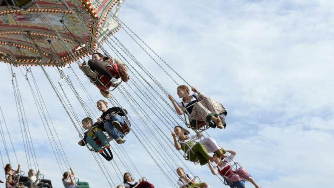 Visitors ride a merry-go-round during the opening day of  the 181st Oktoberfest in Munich