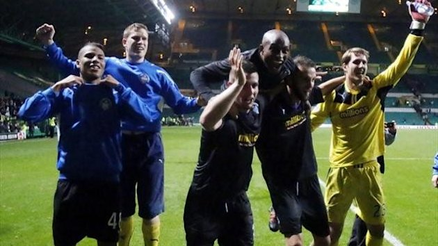 Morton players celebrate their win during the Scottish Communities League Cup, Third round match at Celtic Park