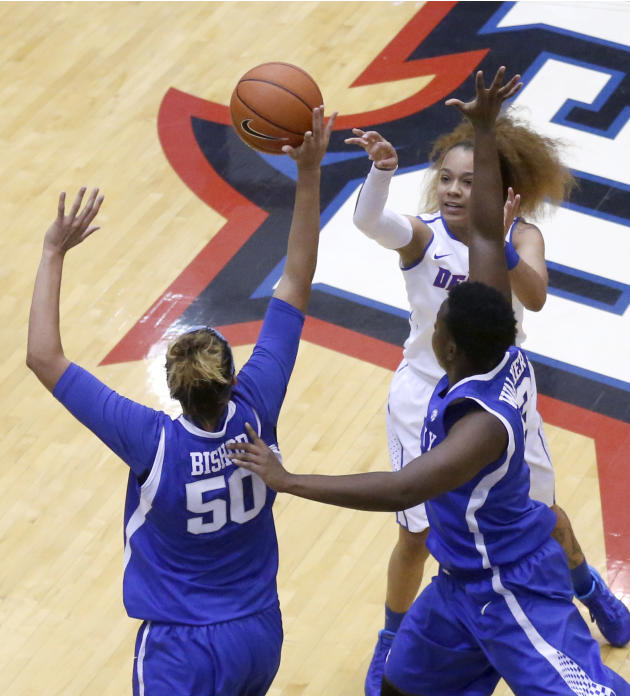 Kentucky forward/center Azia Bishop (50) blocks the shot of DePaul guard Brittany Hrynko as Samarie Walker also defends during the first half of an NCAA college basketball game on Thursday, Dec. 12, 2