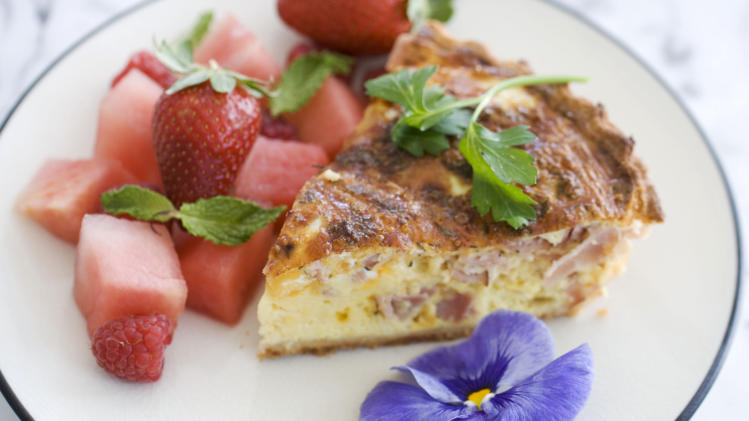 In this image taken on April 22, 2013, a slice of ham and cheddar quiche for Mother's Day is shown served on a plate in Concord, N.H. (AP Photo/Matthew Mead)