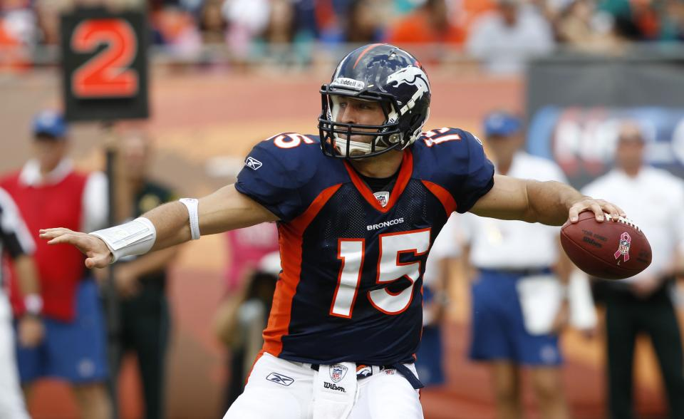 Denver Broncos quarterback Tim Tebow (15) looks to pass during the first half of an NFL football game against the Miami Dolphins, Sunday, Oct. 23, 2011, in Miami. (AP Photo/Hans Deryk)