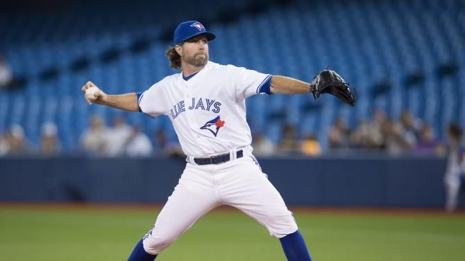 Toronto Blue Jays starting pitcher R.A. Dickey works against the New York Yankees during first inning MLB baseball action in Toronto on Monday, May 4, 2015.  (Darren Calabrese(/The Canadian Press via AP)   MANDATORY CREDIT