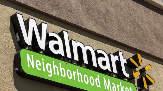 Signage for a newly opened Walmart store is displayed in the Altadena neighborhood of Los Angeles Tuesday, May 28, 2013. Wal-Mart Stores Inc. pleaded guilty on Tuesday to charges the company dumped hazardous waste in Calif. Wal-Mart entered the plea in federal court in San Francisco to misdemeanor counts of negligently dumping pollutants from Walmart stores into sanitation drains across California, a company spokeswoman said. (AP Photo/Damian Dovarganes)