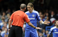 Chelsea's Fernando Torres speaks to referee Mike Dean during their English Premier League soccer match against Swansea City at the Stamford Bridge Stadium, London, Saturday, Sept. 24, 2011. (AP Photo/Tom Hevezi)
