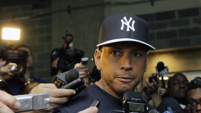 FILE - in this April 1, 2013, file photo, New York Yankees' Alex Rodriguez talks to reporters outside the Yankees' clubhouse in New York. Injuries have kept him off the field for more than half the season and now A-Rod faces discipline from Major League Baseball in its drug investigation, possibly up to a lifetime ban. (AP Photo/Kathy Willens, File)