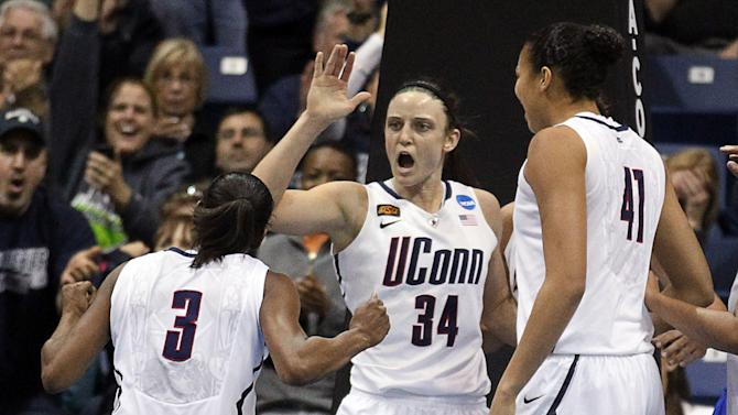 Connecticut guard Tiffany Hayes (3), guard Kelly Faris (34) and center Kiah Stokes (41) celebrate a last-second basket during the first half of the NCAA women's college basketball tournament regional final in Kingston, R.I., Tuesday, March 27, 2012. Connecticut defeated Kentucky 80-65. (AP Photo/Stew Milne)