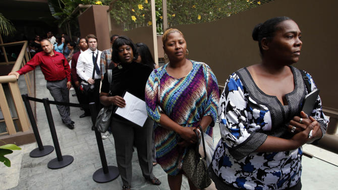 FILE - In this Friday, Aug. 17, 2012 file photo, Sheila Bird, right, waits in line for employment interviews at a job fair at City Target in Los Angeles. Unemployment rates fell in nearly 90 percent of large U.S. metro areas in August, mainly because more people gave up looking for work. The Labor Department said Wednesday, Oct. 3, 2012, that unemployment rates dropped in 329 large cities, the most in four months.  (AP Photo/Nick Ut, File)