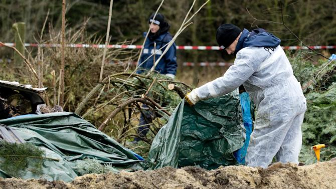 Police search for evidence in the area where body parts were found on November 29, 2013 in Reichenau, eastern Germany