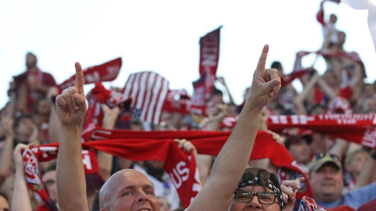 Fans react after USA scores in the second half during an World Cup qualifying soccer match against Honduras at Rio Tinto Stadium on Tuesday, June 18, 2013, in Sandy, Utah. USA defeated Honduras 1-0. (AP Photo/Rick Bowmer)