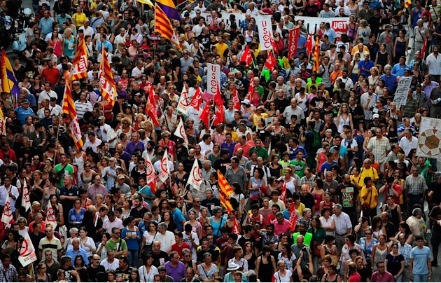 Demonstrators protest against austerity measures announced by the Spanish government in Barcelona, Spain, Thursday, July 19, 2012. The country is in its second recession in three years and its governm