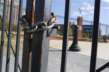 Locked gates secure a pedestrian walkway along the Anacostia River at the Navy Yard installation the day after a shooting rampage, in Washington