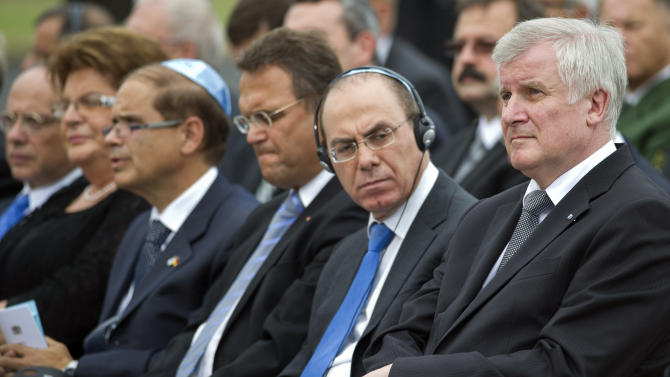Bavarian Prime Minister Horst Seehofer, Israel's deputy Prime Minister Silvan Shalom, German Interior Minister Hans-Peter Friedrich and President of the Central Council of Jews in Germany Dieter Graumann, from right, attend a commemoration ceremony for the assassination victims of the Olympic games in Munich in 1972, at the former airbase in Fuerstenfeldbruck, southern Germany, Wednesday, Sept. 5, 2012. Relatives of Israelis slain by Palestinian gunmen during the games and survivors of the attack are marking its 40th anniversary with German politicians and Jewish leaders at the air base where most of the 12 victims died. Also five terrorists were killed in the failed liberation attempt. (AP Photo/dapd, Lennart Preiss)