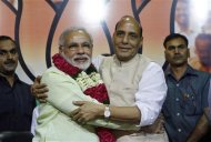 India's Hindu nationalist Narendra Modi (2nd L) hugs Rajnath Singh (2nd R), president of India's main opposition Bharatiya Janata Party (BJP), after Modi was crowned as the prime ministerial candidate for the BJP at the party headquarters in New Delhi September 13, 2013. REUTERS/Anindito Mukherjee