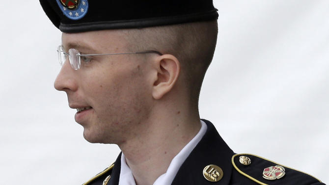 FILE - In this July 30, 2013 file photo, Army Pfc. Bradley Manning is escorted out of a courthouse in Fort Meade, Md. after receiving a verdict in his court martial. Few Americans in living memory have emerged from obscurity to become such polarizing public figures _ admired by many around the world, fiercely denigrated by many in his homeland. (AP Photo/Patrick Semansky, File)