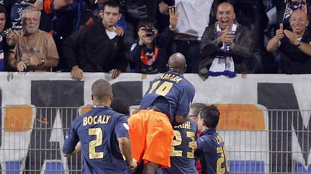 Montpellier players celebrate goal against Arsenal
