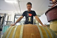 "Chief brewer from ""Birra del Borgo"" brewery, Andrea Lecchini, poses on August 23, in the brewery in the tiny town of Borgorose, some 100 kilometres (62 miles) from Rome. A report by Assobirra, the association of Italian brewers, said 71 percent of Italians drink beer"