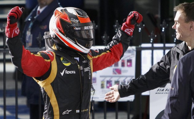 Lotus Formula One driver Kimi Raikkonen of Finland celebrates after winning the Australian F1 Grand Prix at the Albert Park circuit in Melbourne
