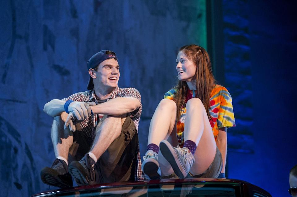 "This theater image released by The Hartman Group shows Jay Armstrong Johnson, left, and Allison Case during a performance of ""Hands on a Hard Body,"" at the  Brooks Atkinson Theater in New York and featuring songs co-written by Phish frontman Trey Anastasio. (AP Photo/The Hartman Group, Chad Batka)"