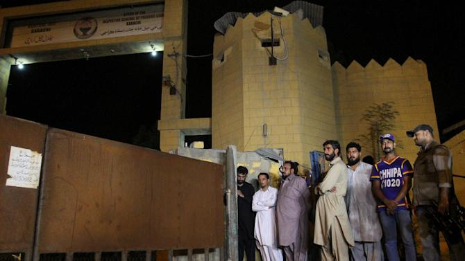 Family members of Shafqat Hussain, who was convicted of killing a boy, wait outside the central prison to receive his body after his execution in Karachi, Pakistan, Tuesday, Aug. 4, 2015. Pakistan has executed Tuesday Hussain, convicted of killing a 7-year-old boy in 2004, his family and lawyers said when he himself was 14 years old, officials at Karachi prison said. (AP Photo/Fareed Khan)