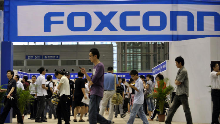 Foxconn denies worker unrest slows iPhone assembly