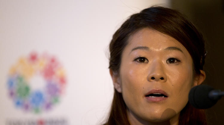 Homare Sawa, Tokyo 2020 bid ambassador and soccer Olympian, listens to a question from the media during the first international presentation of the Tokyo 2020 Olympic Games bid in London, Thursday, Jan. 10, 2013. (AP Photo/Alastair Grant)