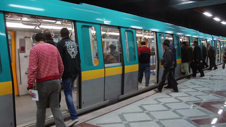Passengers board a metro train in Cairo on February 21, 2012
