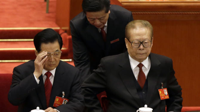 Former Chinese President Jiang Zemin, right, seats next to Chinese President Hu Jintao during the opening session of the 18th Communist Party Congress held at the Great Hall of the People in Beijing, China, Thursday, Nov. 8, 2012. China's ruling Communist Party opened a congress Thursday to usher in a new group of younger leaders faced with the challenging tasks of righting a flagging economy and meeting public calls for better government. (AP Photo/Ng Han Guan)
