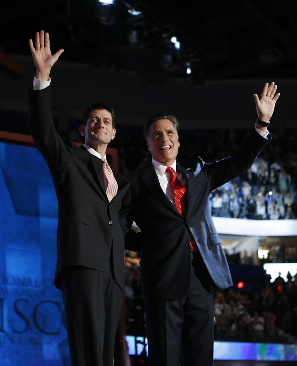 Republican presidential nominee Mitt Romney, right,  joined by Republican vice presidential nominee, Rep. Paul Ryan, waves to delegates after speaking at the Republican National Convention in Tampa, Fla., on Thursday, Aug. 30, 2012. (AP Photo/Charles Dharapak)