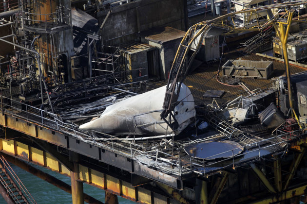 This aerial photograph shows damage from an explosion and fire on an oil rig in the Gulf of Mexico, about 25 miles southeast of Grand Isle, La., Friday, Nov. 16, 2012. Four people were transported to