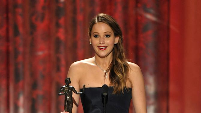 """Jennifer Lawrence accepts the award for outstanding female actor in a leading role for """"Silver Linings Playbook"""" at the 19th Annual Screen Actors Guild Awards at the Shrine Auditorium in Los Angeles on Sunday Jan. 27, 2013. (Photo by John Shearer/Invision/AP)"""
