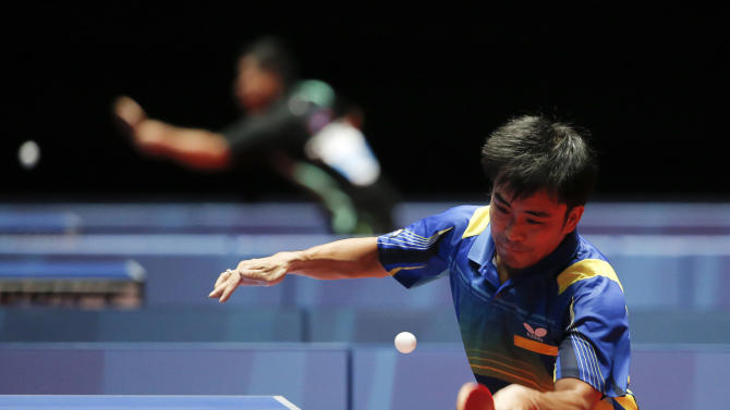 SPO TABLE TENNIS: Table Tennis -  Men's Singles - Vietnam's Tran Tuan Quynh (R) and Laos' Thavisack Pathaphone in action