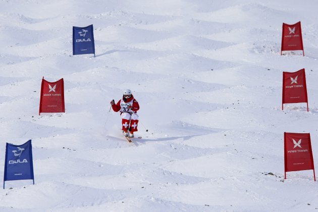 Tade of Switzerland competes during qualification for the dual moguls discipline at the Freestyle Skiing World Championships in Voss