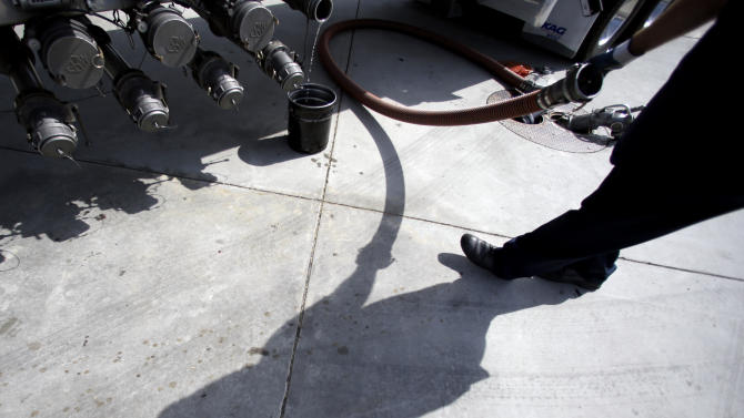 FILE - In this Friday, Oct. 5, 2012, file photo, a gas truck delivery driver fills the tanks at a gas station in Garden Grove, Calif. Gasoline across the U.S. is cheaper Wednesday, Oct. 24, 2012, after a week of rapid price declines. The national average for a gallon of gas has dropped 13 cents in the past week to $3.625. That's the biggest weekly decline since the 7-day period ended Nov. 28, 2008, according to Oil Price Information Services analyst Fred Rozell. (AP Photo/Chris Carlson, File)