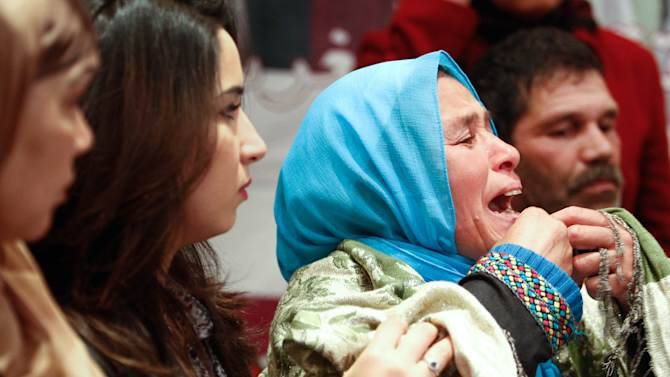 FILE- In this Saturday, April 7, 2012 file photo, Zohra Filali, mother of Amina Filai, right, delivers a petition to the Moroccan government to stop the law which allows rapists to marry their victims and thus exonerate themselves, in Casablanca. Nearly a year after Morocco was shocked by the suicide of a 16-year-old girl who was forced to marry her alleged rapist, the government has announced plans to change the penal code to outlaw the traditional practice. Women's rights activists on Tuesday, Jan. 22, 2013 welcomed Justice Minister Mustapha Ramid's announcement, but said it was only a first step in reforming a penal code that doesn't do enough to stop violence against women in this North African kingdom. Last March, 16-year-old Amina al-Filali poisoned herself to get out of a seven-month-old abusive marriage to a 23-year-old she said had raped her. Her parents and a judge had pushed the marriage to protect the family honor. The incident sparked calls for the law to be changed. (AP Photo/Abdeljalil Bounhar, File)