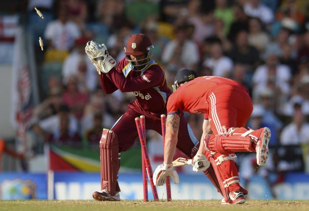 England's Stokes is stumped by West Indies' Ramdin during the first T20 international cricket match at Kensington Oval in Bridgetow