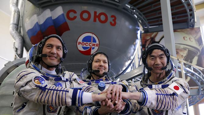Cosmonauts pose for a picture as they attend a training examination at the Gagarin cosmonaut training centre outside Moscow
