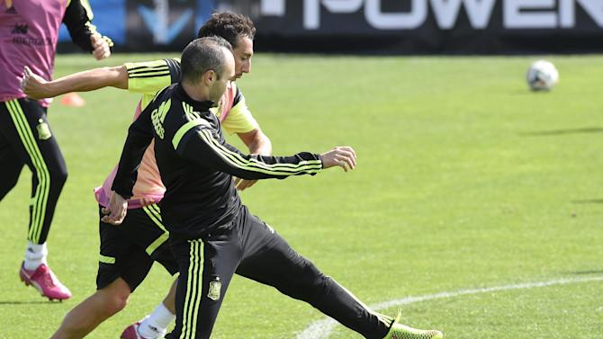 Spanish midfielders Andres Iniesta (left) and Santiago Cazorla take part in a training session in Curitiba, on June 21, 2014