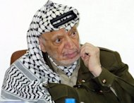 "Palestinian leader Yasser Arafat at his headquarters in the West Bank town of Ramallah in January 2004. The Yasser Arafat Foundation says there is ""no need"" for more proof the Palestinian leader was poisoned in what appeared to be a stance against French plans to exhume his body"