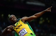 Jamaica&#39;s Usain Bolt celebrates after winning the men&#39;s 100m final at the athletics event during the London 2012 Olympic Games on August 5, in London