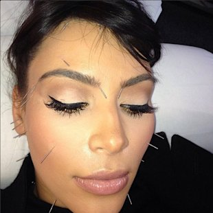 Kim Kardashian shows off her needle studded face in new Instagram snap
